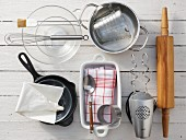 Cooking utensils for the preparation of 'Buchteln' (baked, sweet yeast rolls) with stewed damsons and a vanilla sauce