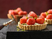 Strawberry tartlets with ricotta cream and pistachios