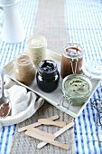 Various vegan nut butters in preserving jars