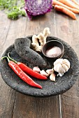 Chilli, garlic and ginger in a stone mortar with pestle