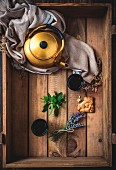 Arabic Nana mint tea in a teapot and glasses on a wooden tray