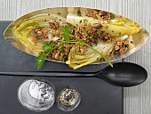 Grilled chicory with parmesan and walnut crumbs
