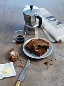 Breakfast with banana bread, espresso and a newspaper