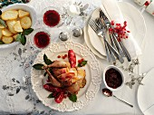 A Christmas dish: roasted pheasant with bacon, pomegranate and potatoes