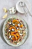 Warm squash salad with couscous, chickpeas and feta cheese