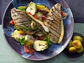 Gilt-head bream fillets with an artichoke salad