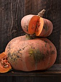 Two stacked orange pumpkins