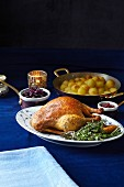 Roast duck with a bouquet garni and side dishes