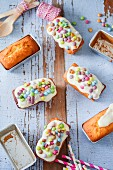 Small loaf cakes with icing and colourful chocolate beans