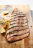 Grilled salmon on a chopping board
