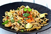 Tagliatelle pasta with salmon, lime and coriander leaves