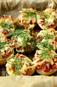 Potatoes stuffed with minced beef, cheese and dill