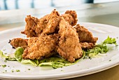 Fried chicken tenders on lettuce