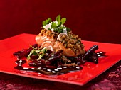 A salmon fillet with horseradish breadcrumbs and a beetroot sauce