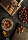 Chocolate truffles on a dark wood background
