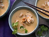 Sweet potato and coconut soup with chicken cubes