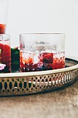 Berry drink with ice cubes