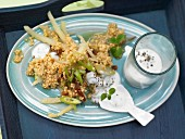 Millet and vegetable pot with mint yoghurt sauce