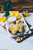 Palmier pastries with almond flakes and orange cream