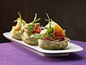 Artichoke bases with pickled seafood and salad