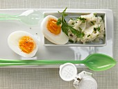 Egg with a vegetable and parsley dip