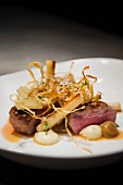 Lamb medallions with salsify, courgette and watercress