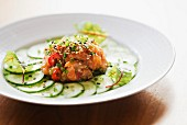 Korean-style salmon tartare with slices of cucumber