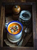 A bowl of vegan pumpkin soup with coconut milk and saffron