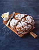 Soda bread and butter on a wooden board