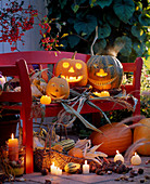 Halloween, pumpkin faces arranged on a bench
