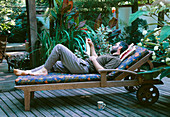 MIKE DRYFOOS RELAXES On THE DECK . DESIGNERS: ILGA JANSONS AND MIKE DRYFOOS, Seattle, USA