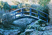 FROSTED Blue WOODEN BRIDGE OVER A SMALL STREAM at THE LANCE HATTATT DESIGN Garden at ARROW Cottage, Herefordshire