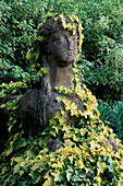 STONE Sphinx CLOTHED IN HEDERA HELIX 'Buttercup' with Fuchsia 'SHARPITOR' IN B / G. Helen DILLON'S Garden