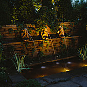 NIGHT-LIT Formal POND with THREE Monkey Water SPOUTS. LIGHTING by Garden & Security LIGHTING. NATURAL & ORIENTAL Water GARDENS, HAMPTON Court 97.
