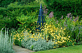 Blue TRIPOD SURROUNDED by ANTHEMIS TINCTORIA 'E C BUXTON' AND Artemisia LUDOVICIANA 'VELERIE FINNIS'. ARROW Cottage, Herefordshire