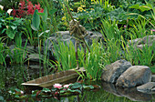 Water Feature: Water Garden with SCULPTURE by DAVID GOODE AND Iris ENSATA, ASTILBES & ARUM LILIES, LIT by Garden & Security LIGHTING. HAMPTON