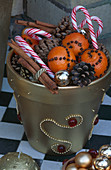 Gold Pot with FIR CONES, CINNAMON STICKS, Candy CANES AND Oranges with CLOVES