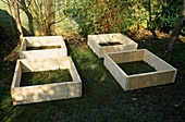 WOODEN SCAFFOLDING BOARDS USED TO MAKE RAISED BEDS FOR THE DECORATIVE CHILDRENS POTAGER