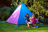 Nancy SITS On A DECK CHAIR WHILST HARRIET, JOSHUA AND Robert Look OUT of THE Home Made TENT IN Clare MATTHEWS Garden, READING
