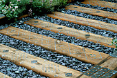 Grey SLATE AND WOODEN SLEEPERS by DAVID ROSEWARNE AND Magie GRAY / CHELSEA