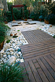 ROOF Garden with Red CEDAR DECKING, BAMBOO LOUNGERS, White Boulders AND BARLEYCORN GRAVEL. DESIGN by ALISON WEAR ASSOCIATES