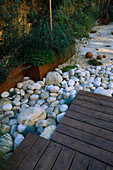 ROOF Garden with BAMBOO FENCING, White Boulders AND Red CEDAR DECKING: DESIGN by ALISON WEAR ASSOCIATES