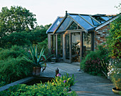 VIEW of DECK with Pool, Agave AMERICANA IN Container AND Garden ROOM BEHIND. THE FOVANT Hut, Wiltshire