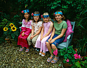 Designer Clare MATTHEWS: CHILDRENS Party - Four GIRLS On A Blue BENCH WEARING SELF Made Party HATS