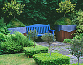 RIDLER'S Garden, SWANSEA, Wales: VIEW Along PATH PAST Box SQUARES TO Blue BENCH with LEAD AND Rusty Metal CONTAINERS Beside PLANTED with HOLLY AND Box
