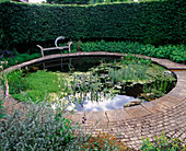 WINGWELL NURSERY, Rutland: CIRCULAR Pool (POND) with STONE SEAT AND Water SCULPTURE 'New Moon' by GEORGE CUTTS