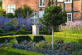 DAVID HARBER SUNDIALS: Front Garden with ARMILLARY SPHERE SUNDIAL, Formal Box BEDS with Purple SAGE, PEROVSKIA AND LAVENDER with STANDARD HOLLY TREE (ILEX)