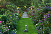 WILKINS PLECK, Staffordshire: VIEW From THE HOUSE Along GRASS PATH with Double HERBACEOUS BORDER AND SUNDIAL