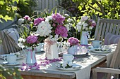 Pink and white peony table decoration on the terrace