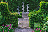 RIDLER'S Garden, SWANSEA, Wales: VIEW Along PATH with CHIVES AND YEW HEDGE TO SCULPTURE by Helen SINCLAIR. Designer: TONY RIDLER